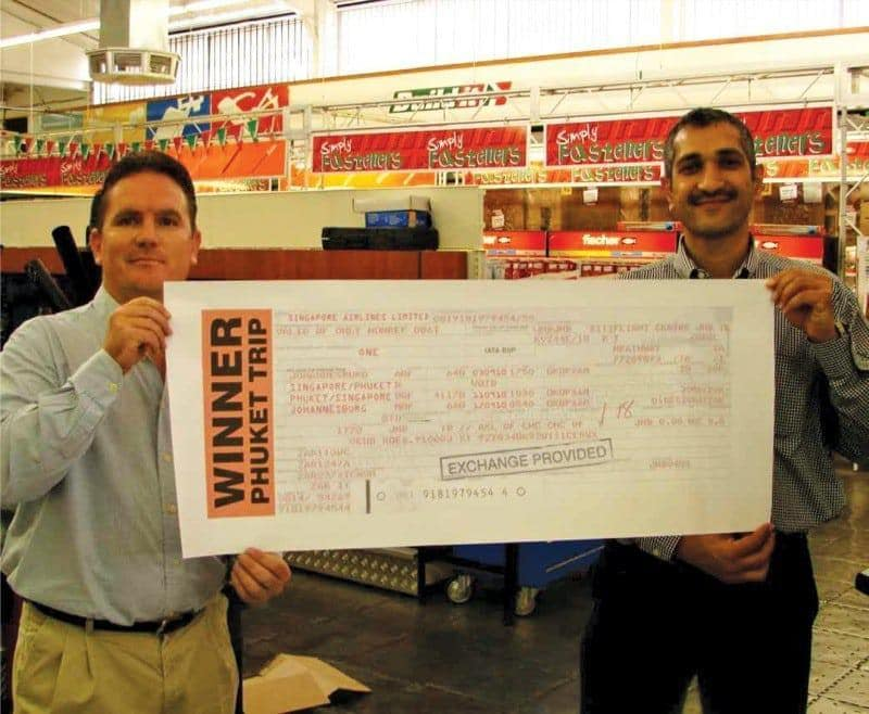 Manny Patel of Supreme Enterprises receives the prize of a lifetime from Theo Reinecke of Matus.